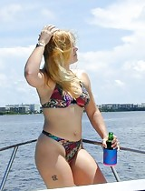 Blonde mom spreading out on a boat